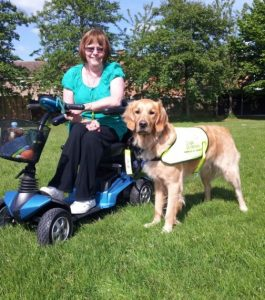 Susan with Miller Dogs For Good golden retriever assistance dog