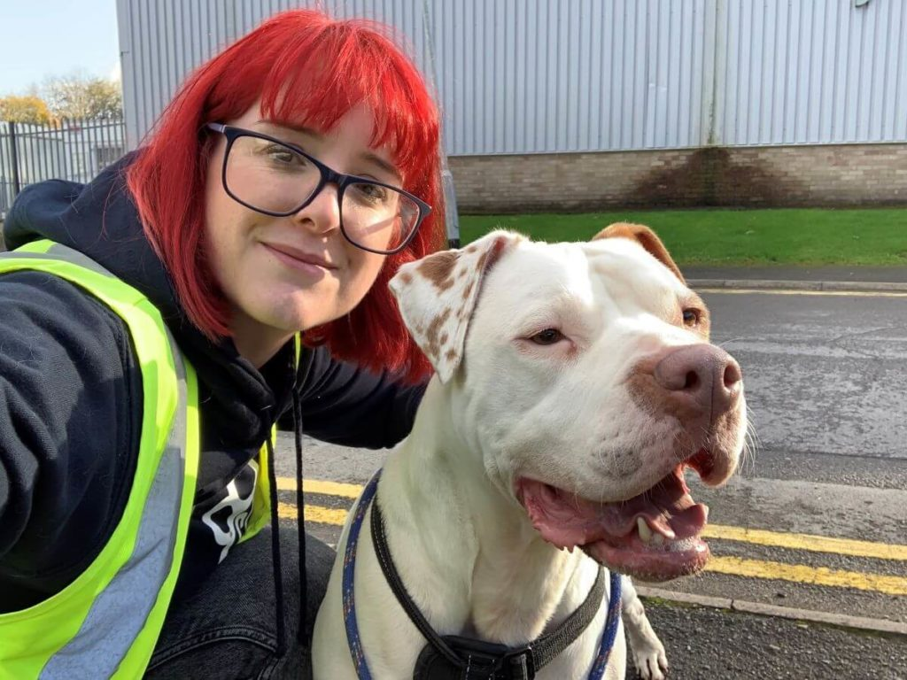 Girl with red hair and rescue dog Emily at Cardiff Dogs Home
