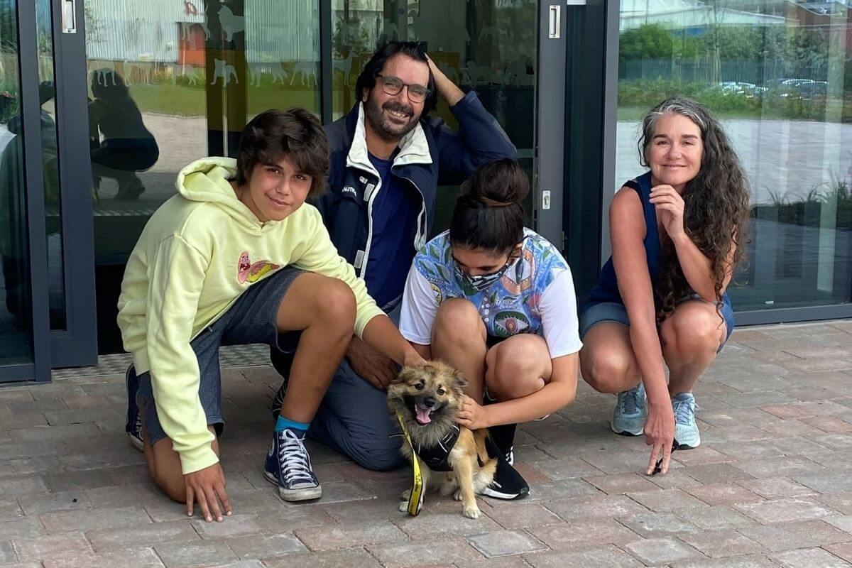 family with rescue dog outside dogs trust cardiff